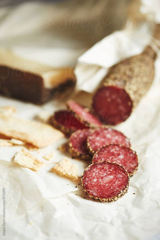 Salami with crackers by Asami Zenri for Stocksy United
