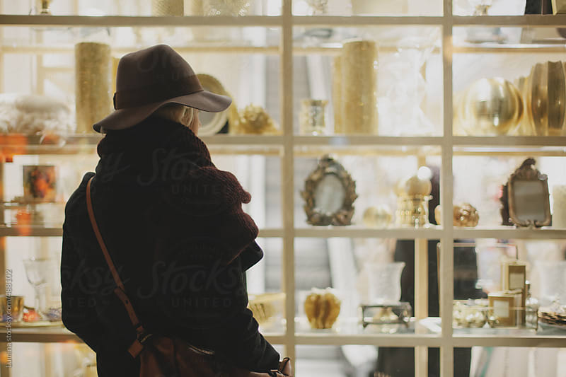Woman in Front of a Shop Window by Lumina for Stocksy United