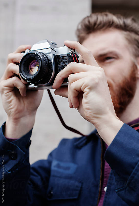 Taking photos with analog film camera. by W2 Photography for Stocksy United