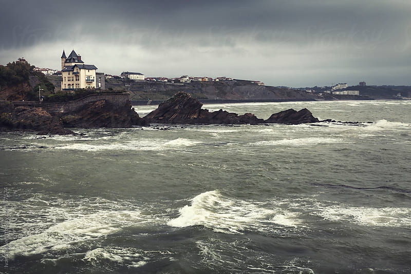 Rocky coast on a cloudy day in Biarritz, France by Ivan Bastien for Stocksy United