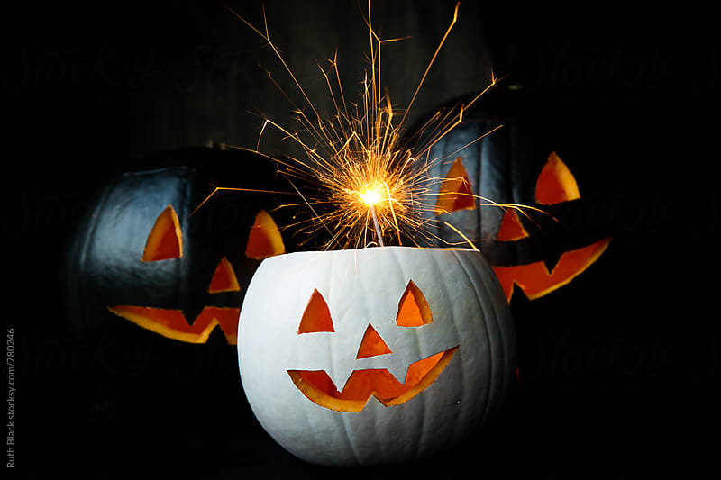 Jack o lanterns with a sparkler by Ruth Black for Stocksy United