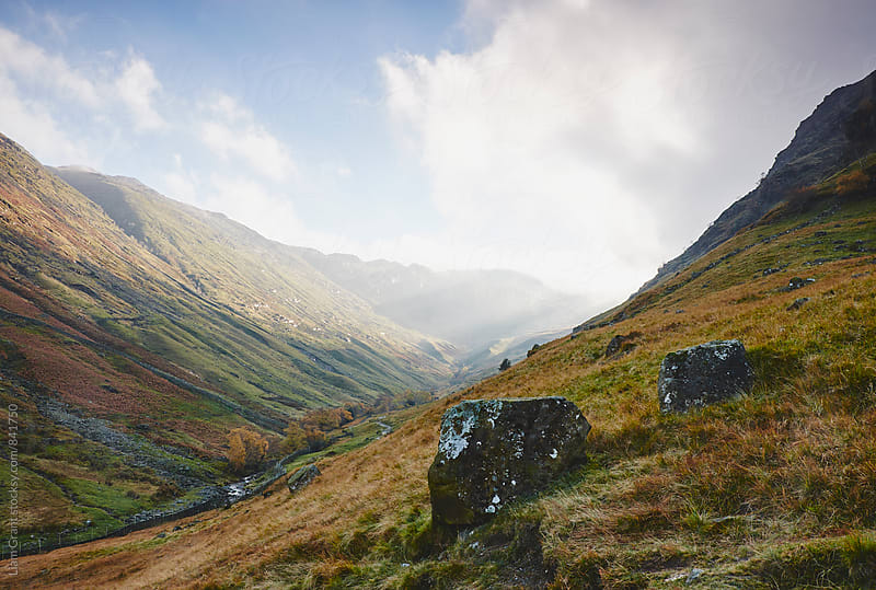 Light breaking through cloud. Seathwaite, Cumbria, UK. by Liam Grant for Stocksy United