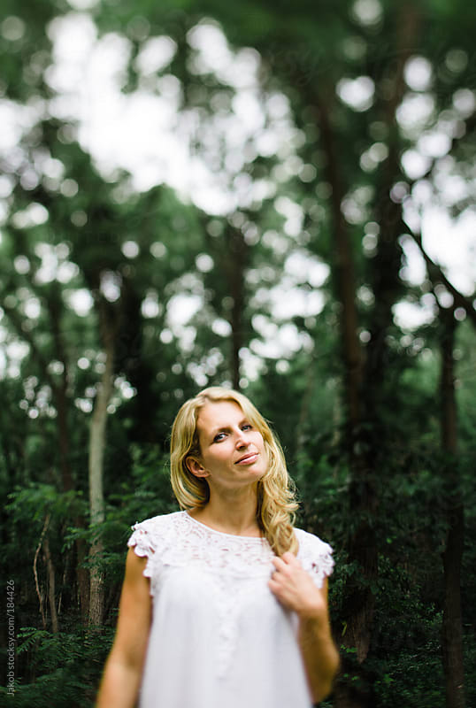 Blonde girl in a forest by Jakob for Stocksy United
