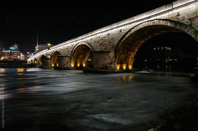 Night shot of the Stone Bridge in Skopje, Macedonia   by Leander Nardin for Stocksy United