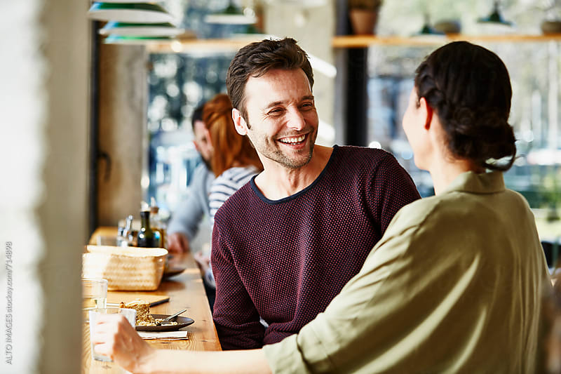 Smiling Man With Woman In Restaurant by ALTO IMAGES for Stocksy United