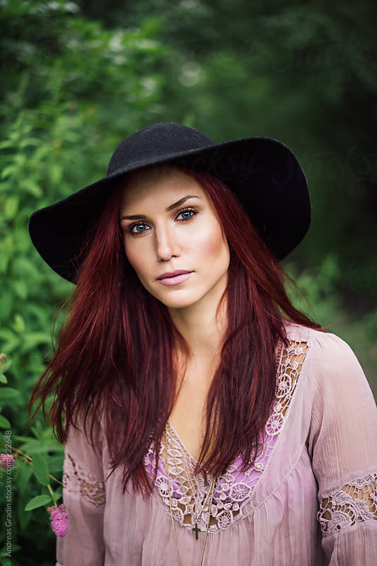 summer hat girl by Andreas Gradin for Stocksy United