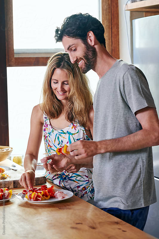 Couple preparing food by Daxiao Productions for Stocksy United