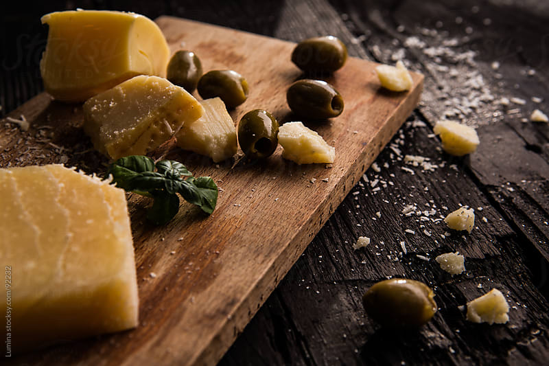 Parmesan Cheese and Olives by Lumina for Stocksy United