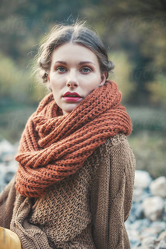 Portrait of a woman in autumn nature by Aleksandra Kovac for Stocksy United
