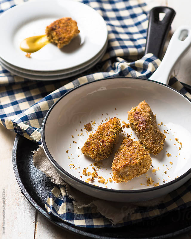 Roasted homemade Parmesan chicken nuggets with spices by Trent Lanz for Stocksy United