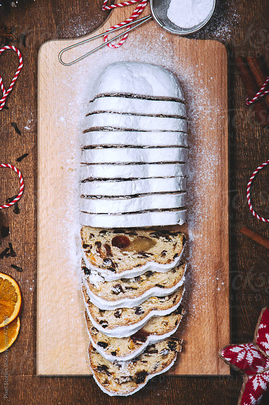 Food: traditional Christmas stollen cake by Pixel Stories for Stocksy United