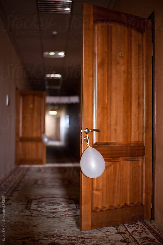 Balloon on the door-handle by Svetlana Shchemeleva for Stocksy United