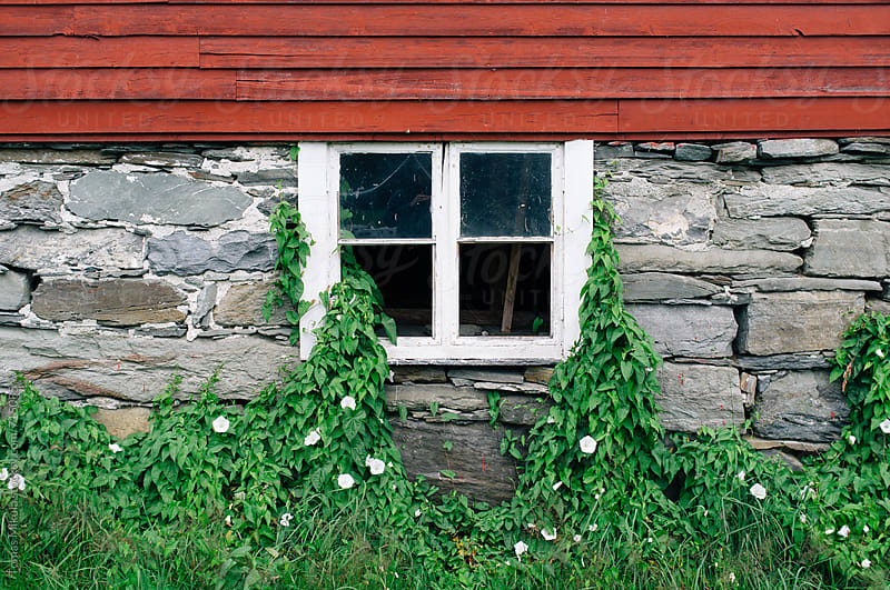 Old window in wooden house by Tomas Mikula for Stocksy United