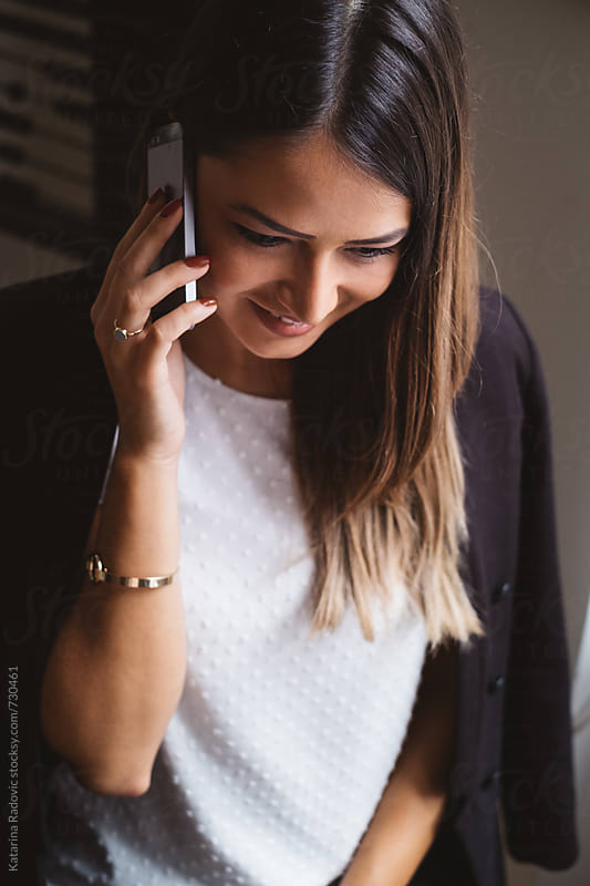 Beautiful Businesswoman Talking on a Phone  by Katarina Radovic for Stocksy United