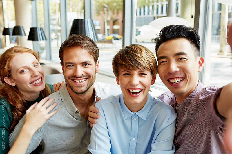 Cheerful Friends Making Selfie In Restaurant by ALTO IMAGES for Stocksy United