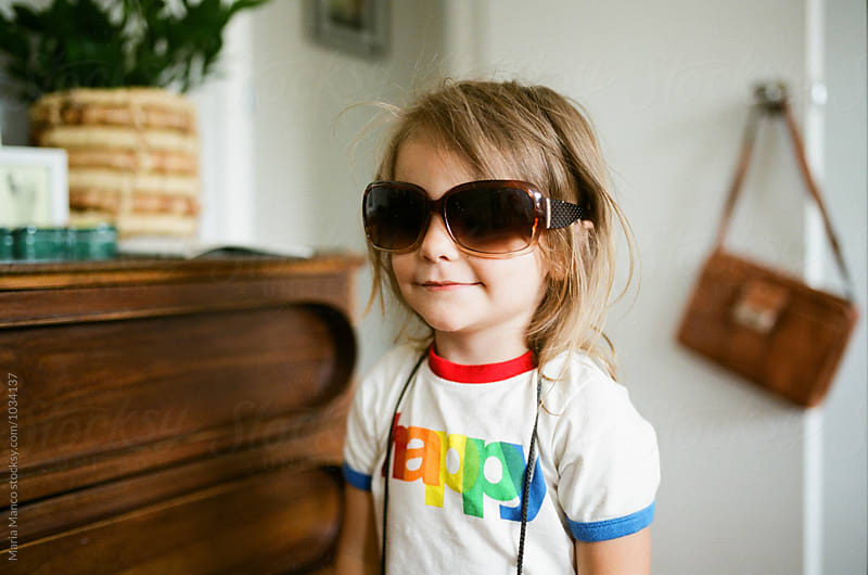little girl in oversized sunglasses by Maria Manco for Stocksy United