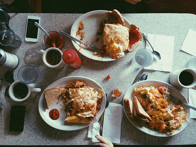 Breakfast Food on Restaurant Table by Kevin Russ for Stocksy United
