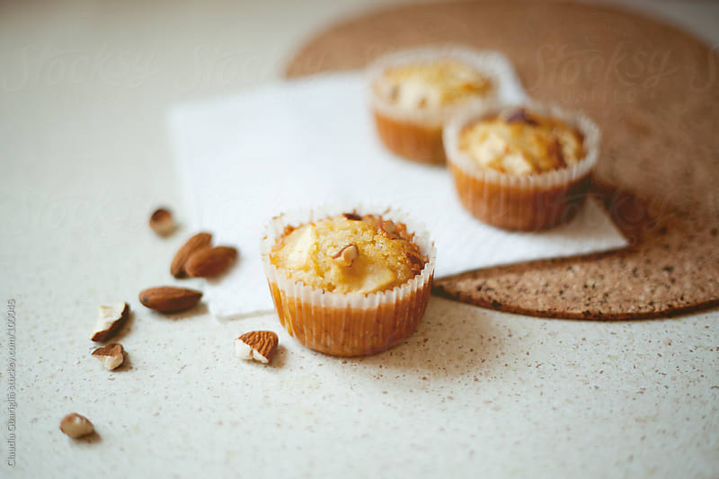 Apple and almond muffins by Claudia Guariglia for Stocksy United