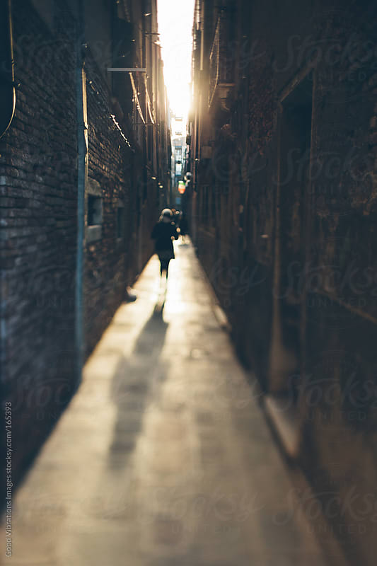 Walking in an Alley at Sunset by Good Vibrations Images for Stocksy United