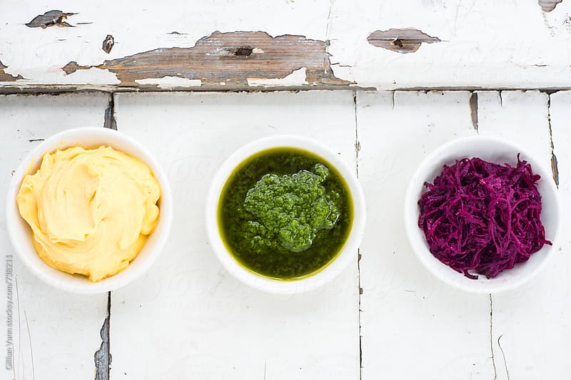 trio of dips, aioli, pesto and beetroot relish by Gillian Vann for Stocksy United