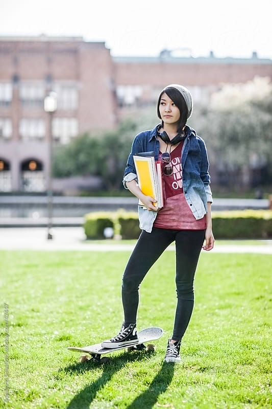 Asian college student on campus by Suprijono Suharjoto for Stocksy United
