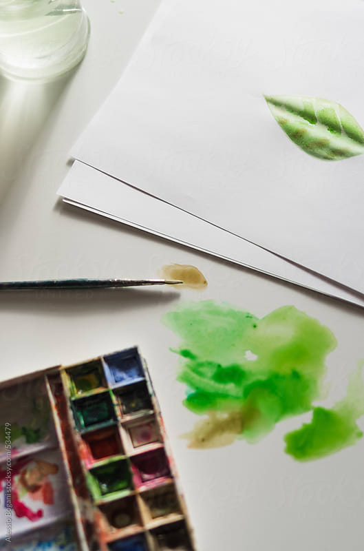 Watercolor leaf on paper by Alessio Bogani for Stocksy United