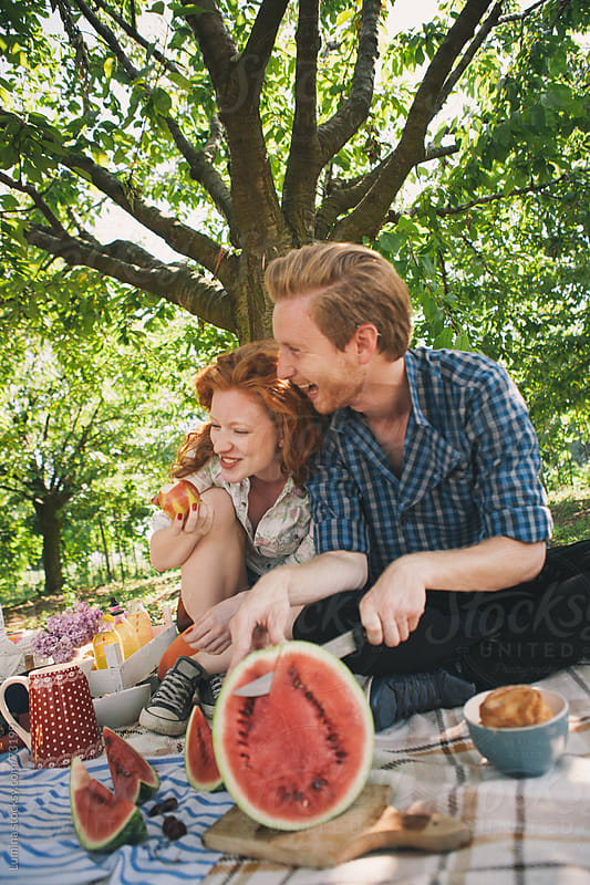 Happy Couple on a Picnic by Lumina for Stocksy United