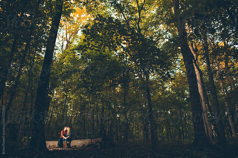 young couple alone in the forest by Brian Powell for Stocksy United