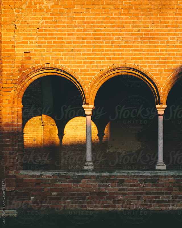 Sun setting on ancient abbey's arcade in Italy by Laura Stolfi for Stocksy United