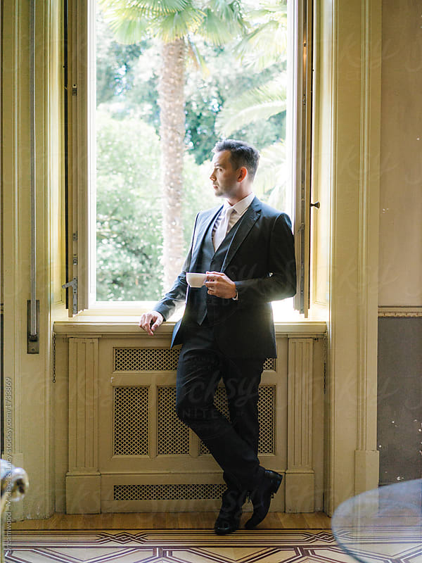 Stylish groom in suit posing in window by Dreamwood - Michael ...