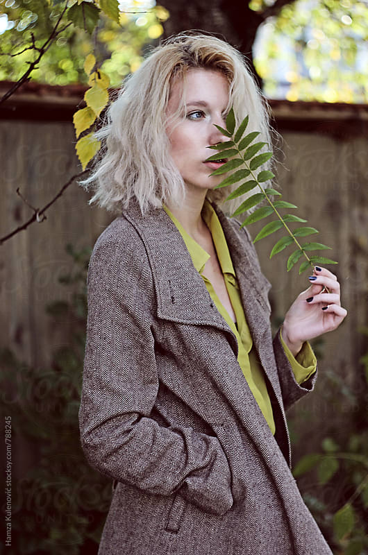 Girl who loves autumn by Hamza Kulenović for Stocksy United