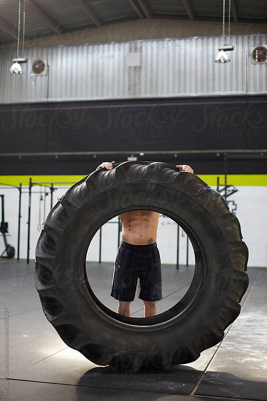 Big size tire for workout in a gym by Miquel Llonch for Stocksy United