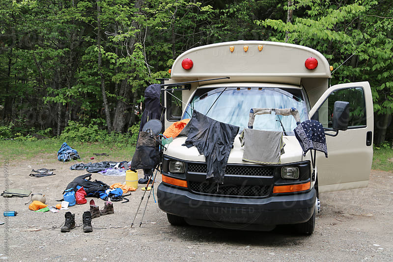 Drying oudoor camping equipment while living and travelling in bus by Matthew Spaulding for Stocksy United
