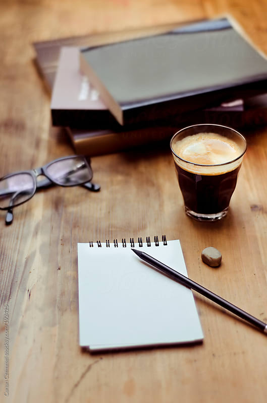 work place with coffee and notepad by Canan Czemmel for Stocksy United