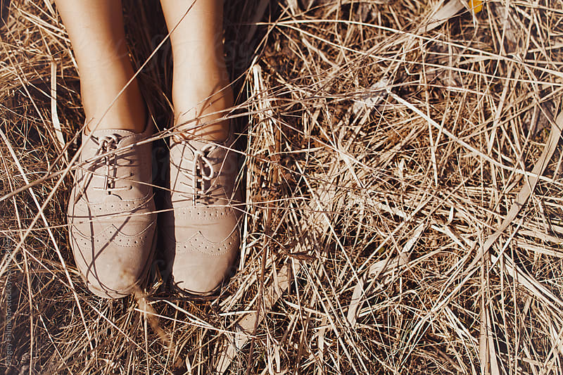 Beige boots on an old grass by Sergey Filimonov for Stocksy United