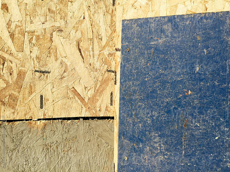 Paint on pieces of plywood from building exterior, close up by Paul Edmondson for Stocksy United