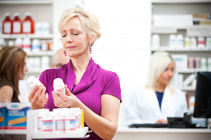 Pharmacy: Mature Woman Unsure of What to Buy by Sean Locke for Stocksy United