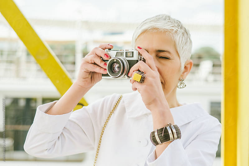 Senior Woman Taking Pictures with Analog Camera by Aleksandra Jankovic for Stocksy United