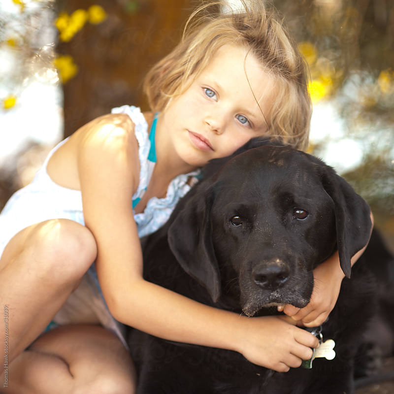 Girl and Her Dog by Thomas Hawk for Stocksy United