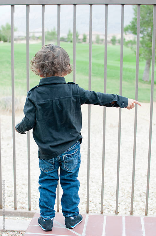 toddler points that way by Tara Romasanta for Stocksy United