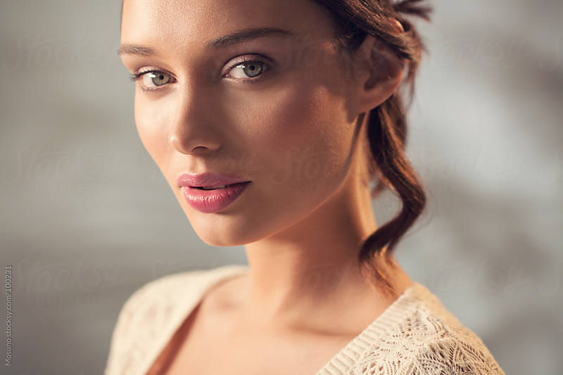 Beautiful Young Brunette Looking at Camera by Mosuno for Stocksy United