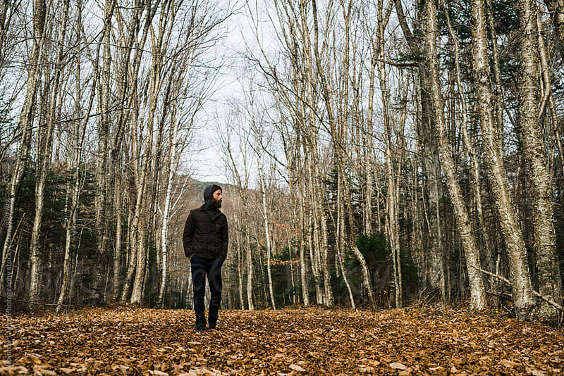 Man standing alone on trail by Isaiah & Taylor Photography for Stocksy United