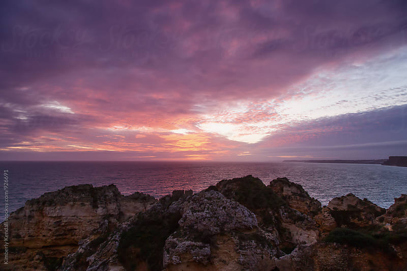 Colorful Sunset along a Rocky Coast by Kimberly Kendall for Stocksy United