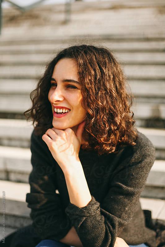 Happy woman smiling outdoor by Marija Kovac for Stocksy United