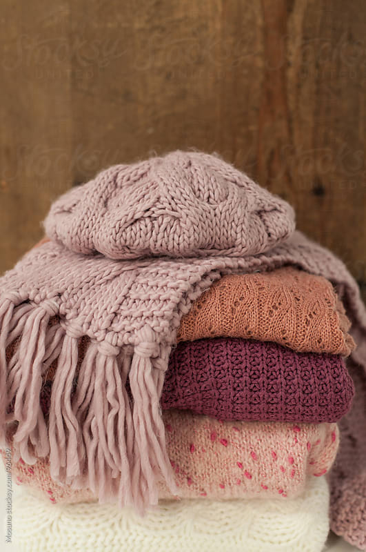 Stack of Winter Clothes by Mosuno for Stocksy United