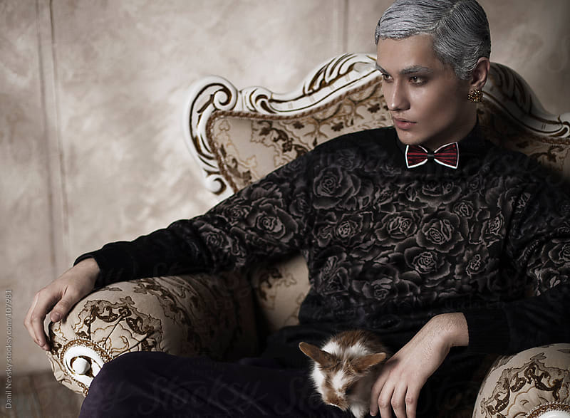 Glamour man sitting on vintage chair or throne by Danil Nevsky for Stocksy United
