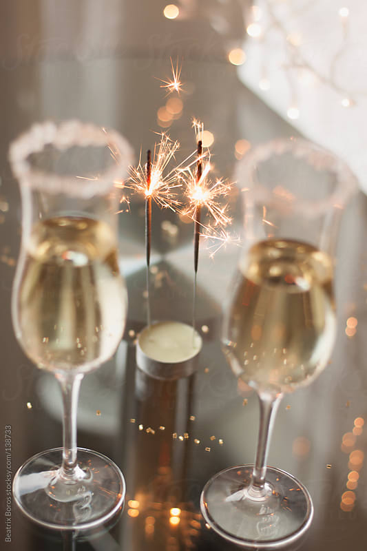 2 sparklers with 2 glasses of Champagne for celebration by Beatrix Boros for Stocksy United