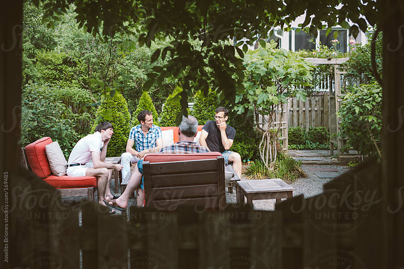 Group of Gay Men Friends at Spring Drinks Party in a Home Backyard Garden by Joselito Briones for Stocksy United