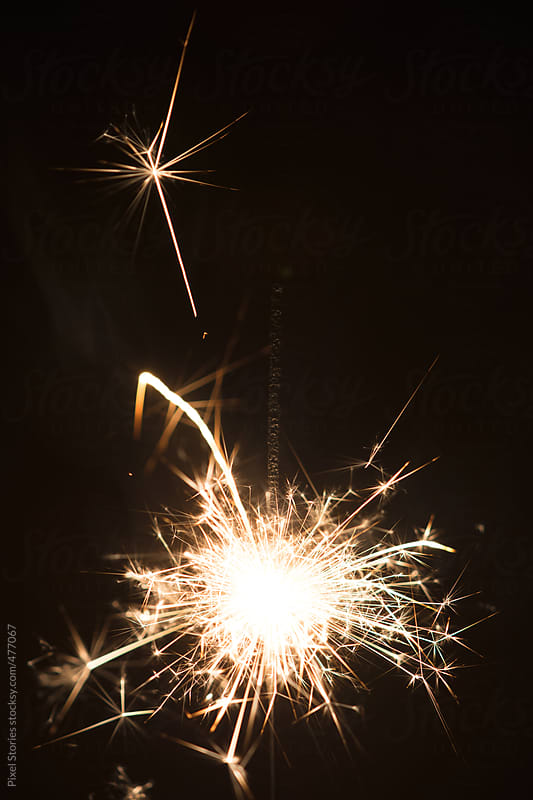 Festive sparkler closeup by Pixel Stories for Stocksy United