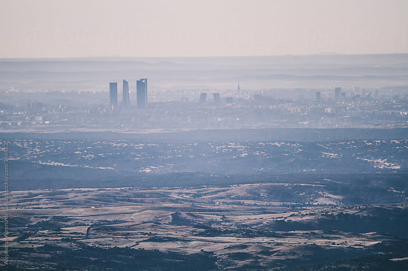 Cityscape skyline view of Madrid. City aerial view with mist by Alejandro Moreno de Carlos for Stocksy United